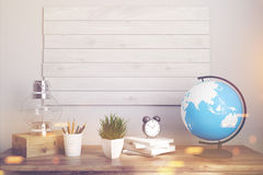 Kids room or home office brown table toned. Interior of a kids room with a wooden table, boards on a wall, an oil lamp, an alarm clock and a globe. Elements of Royalty Free Stock Image