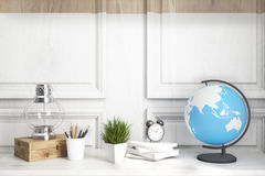 Kids room or home office white table, wood. Interior of a kids room with a white wooden table, a wooden wall, an oil lamp, an alarm clock and a globe. Elements Stock Photos