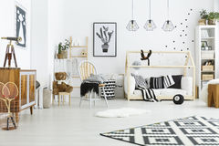 Kids room with house bed. Dresser, chair and bookshelf Stock Image