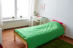 Kids room interior with bed, table and accessories Stock Photos