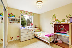 Kids room interior in soft ivory Royalty Free Stock Photography