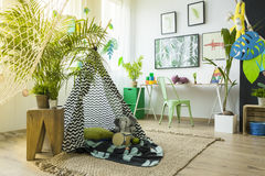 Kids room with play tent. Desk and green chair Stock Photography