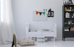 Kids room with white crib Stock Images