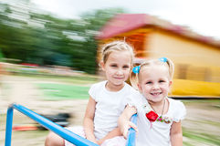 Kids rotate on a carousel Royalty Free Stock Images