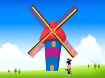 Kids rotating windmill Royalty Free Stock Photos