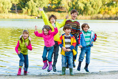 Kids in rubber boots stock photos