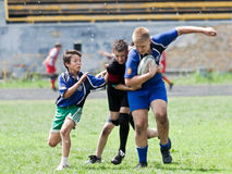 Kids rugby match. Royalty Free Stock Image