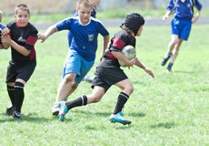 Kids rugby match. Royalty Free Stock Images
