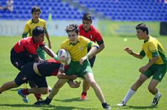 Kids Rugby Players. Children rugby players pictured in action during the Romanian Youth Rugby Championship final between CS Olimpia and CSO Pantelimon Royalty Free Stock Photo