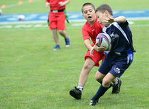 Kids Rugby Players Royalty Free Stock Images