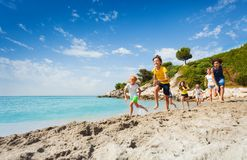 Kids run on the beach at summer hot day Royalty Free Stock Images