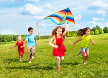 Kids run with kite Stock Photo