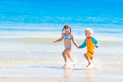 Kids run and play on tropical beach Stock Photography
