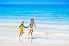 Kids run and play on tropical beach Royalty Free Stock Photos