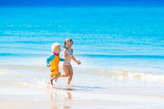 Kids run and play on tropical beach Royalty Free Stock Images