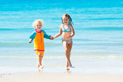 Kids run and play on tropical beach Royalty Free Stock Photo