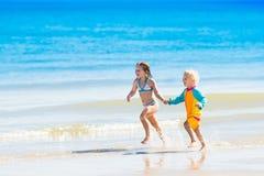 Kids run and play on tropical beach Stock Photo