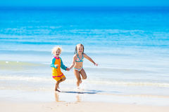 Kids run and play on tropical beach Royalty Free Stock Photography
