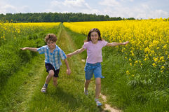 Kids running. On green meadow Royalty Free Stock Image