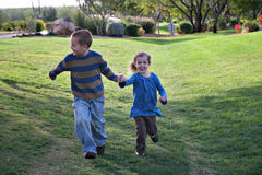 Kids Running. Holding Hands at Park Stock Photography