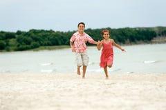 Kids running. Happy kids running on the beach Royalty Free Stock Photo