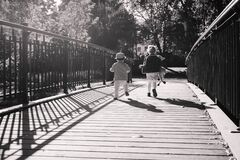 Kids running across the bridge Royalty Free Stock Images