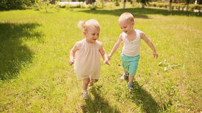 Kids running across green grass and fall.  stock footage