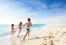 Free Kids Running Along Beach During Summer Vacation Stock Photography - 103349222