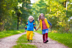 Kids running in autumn park Stock Image