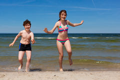 Kids running on beach Royalty Free Stock Image