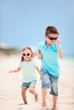 Kids running at beach Royalty Free Stock Photos