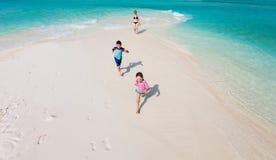 Kids running at beach Royalty Free Stock Photo