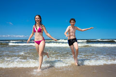 Kids running on beach. Girl and boy running, playing on beach Royalty Free Stock Photo