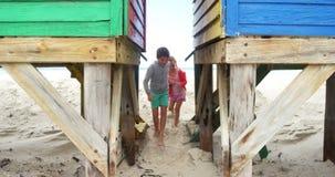 Kids running through beach hut. During winter stock video