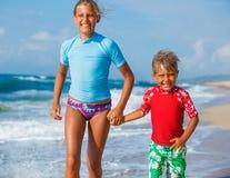 Kids running at beach stock photos