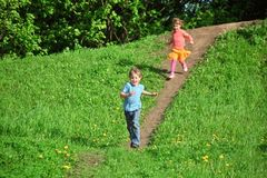 Kids running down the hill Stock Photos