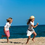 Kids running after each other. Royalty Free Stock Photo