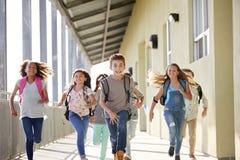 Kids running in elementary school corridor, close up. Kid in elementary school corridor, close up stock photos