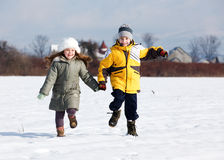 Kids running in field Royalty Free Stock Images