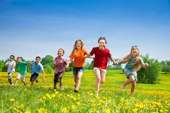Kids running in the field stock photo