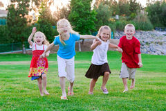 Kids running on the grass stock photo