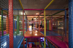 Kids running inside a Colorful indoor playground Stock Images