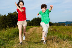 Kids running, jumping outdoor Royalty Free Stock Photos