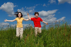 Kids running, jumping outdoor Stock Image