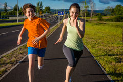 Kids running, jumping outdoor Royalty Free Stock Image
