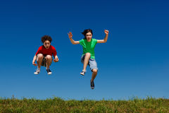 Kids running, jumping outdoor Royalty Free Stock Photo