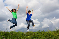 Kids running, jumping outdoor Stock Photos