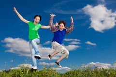 Kids running, jumping outdoor Stock Photo