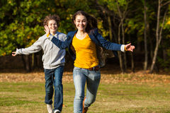 Kids running, jumping outdoor Royalty Free Stock Images