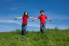 Kids running outdoor Stock Image